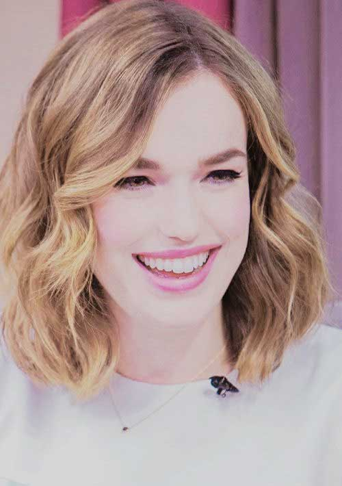 Elizabeth Henstridge Shoulder Length Layered Bob with Bangs