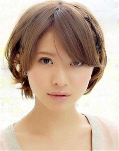 Short Bob Cut with Bangs for Round Face